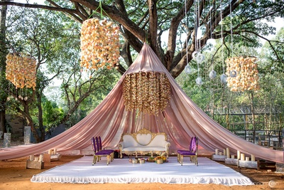 Unique tent style mandap with hanging floral chandeliers