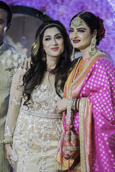 Azhar's mother posing with the evergreen Rekha.