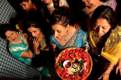 Thaali decorated for Pooja ceremony with rose petals