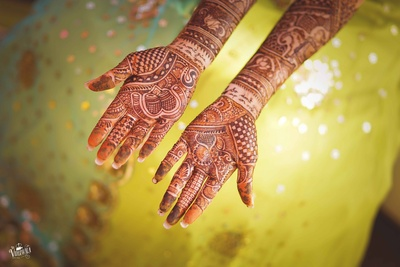 Hand mehndi design with a beautiful message in it.