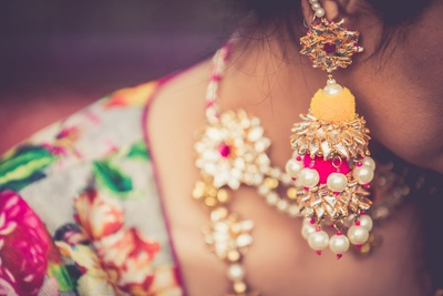 Neon yellow and pink, floral and pearl jewellery.