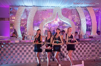 Shot girls in the thematic cocktail party