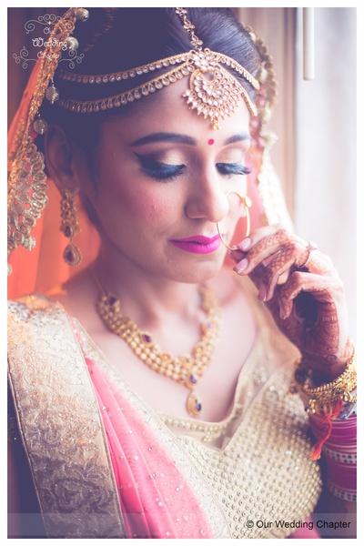 Radiant bridal makeup accentuating the jewellery and lehenga look by MUA Guru Singh