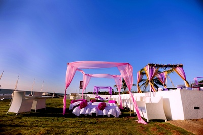 Pink cabanas with white gadda's and fuschia bolsters
