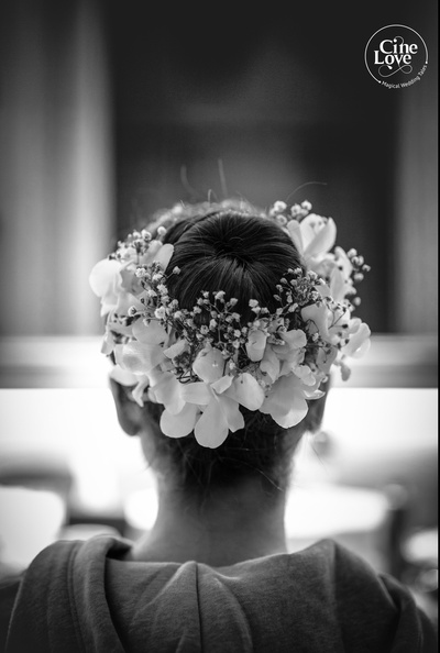 The bride flaunting her bridal juds with flowers and baby breaths, for her wedding ceremony.
