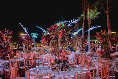 Stunning tropical table seating arrangement for the welcome party!