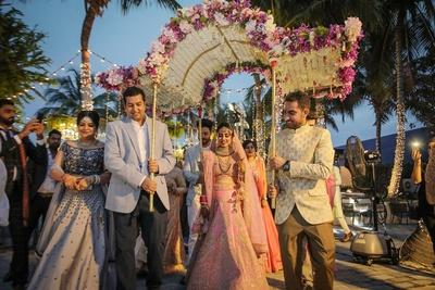 The bride entering under a unique phoolon ki chadar