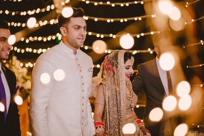 Bride and groom captured in a candid shot post the wedding ceremony