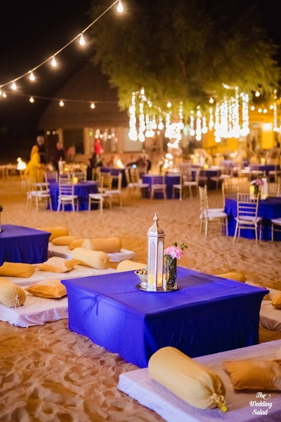 A moroccan-themed sangeet with diwan-like seating amidst the desert.