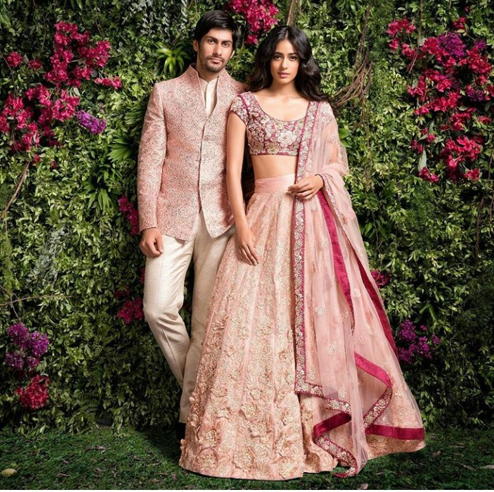 1. Baby pink lehenga full of heavy floral work paired with a maroon blouse. Perff!