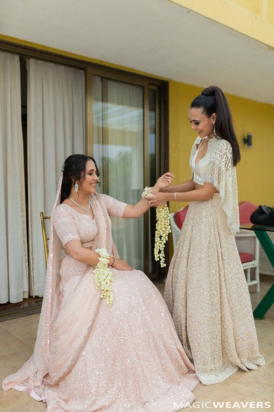 Candid picture of the bride with her sister