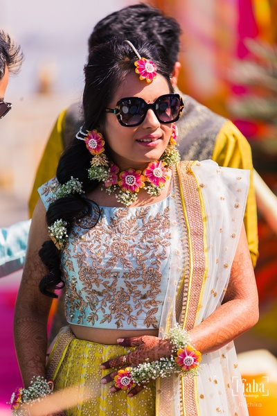 We are drooling over the bride's gorgeous outfit and even more beautiful floral jewellery!