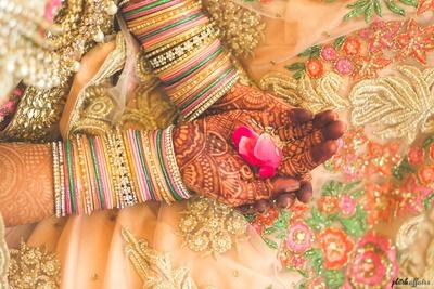 bride in the wedding mandap as the ceremony progresses