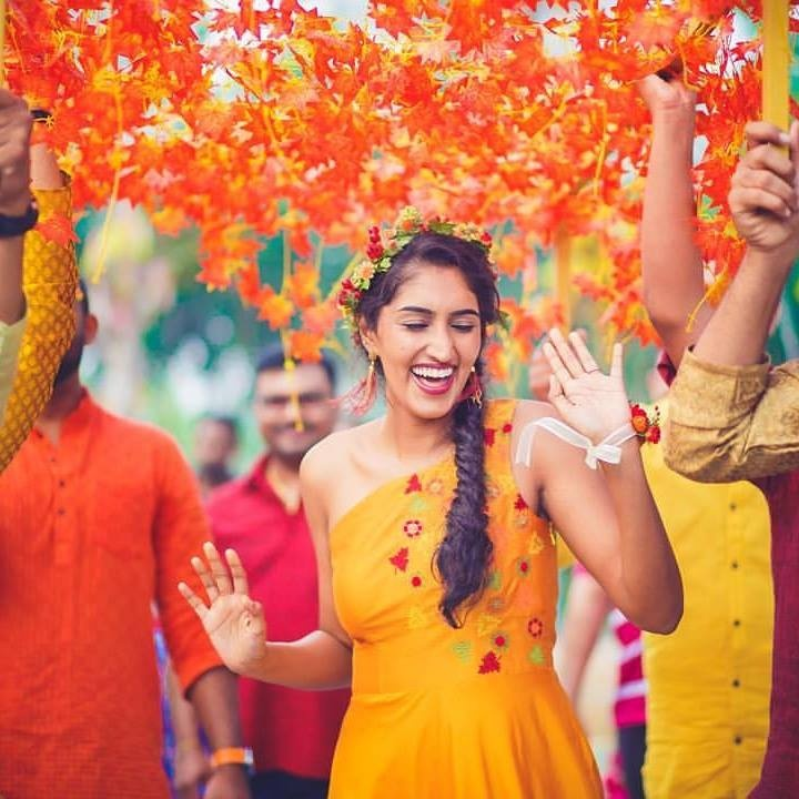 8. A bright orange chaadar made of artificial flowers