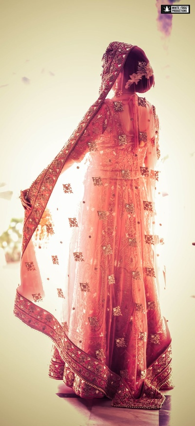 Our sikh bride looks ethereal in a pink and gold lehenga with intricate embroidery