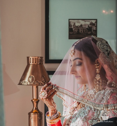 Beatiful bride in a classic wedding shoot in a Manish Malhotra suit.