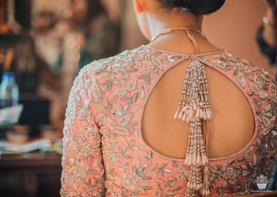 Bride getting ready for the Wedding in a Manish Malhotra punjabi suit.