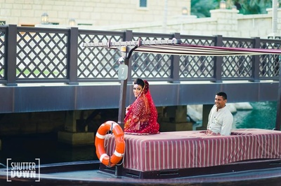 The bride entering her wedding in a boat!