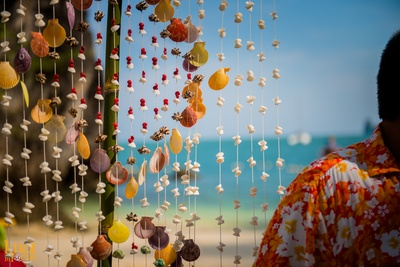 Inspirational beach side decoration with colorful shell strings