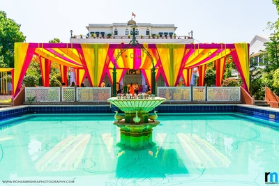 Pink, orange and yellow drapes for a color coordinated mehendi decor