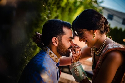candid couple photography before the mehndi ceremony