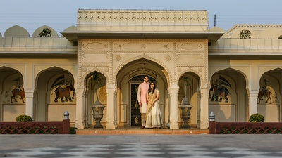 The couple posing against a royal backdrop