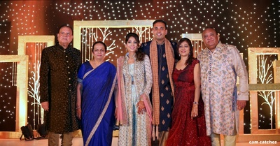 bride and groom with family for the sangeet ceremony