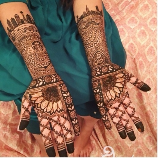 bride has her love for coffee, music and her favourite city's skyline drawn in her Mehendidesign | Indian Bridal Mehendi Design | beautiful mehendi design | Sunflower design on Mehendi Design | Function Mania