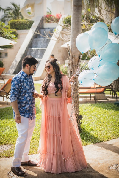 Candid click of bride and groom at their welcome party with balloons