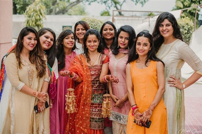 Bride and her bridesmaids at her chuda ceremony