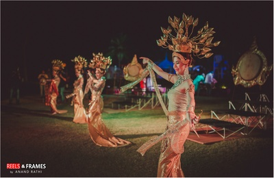 Thai girls in elegant attire performing the dance to entertain the guests with their beautiful smiles