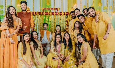 The couple with bridesmaids and groomsmen at the haldi