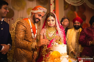 Sahil and Gupreet cutting their super cute wedding cake.