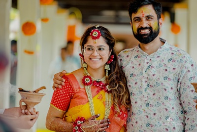 the couple posing at their haldi ceremony