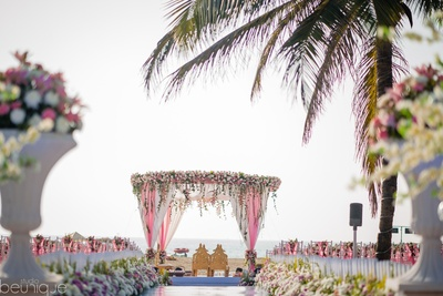 beautiful pink and white floral decor for the beach mandap