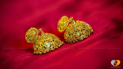 Gold intricately designed jhumkas