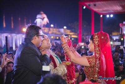 Red bridal lehenga embellished with zardozi work and gold sequins