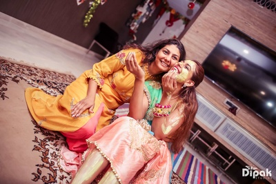 The bride poses with family during her haldi function