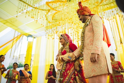 Candid photography aptly captured for an outdoor yellow and white themed wedding function