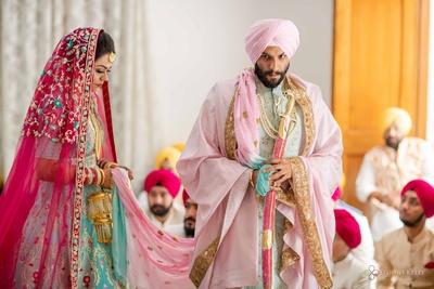 The couple taking pheras during their Anand Karaj ceremony.