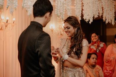 Exchanging rings as Laiyan Laiyan plays in the background.