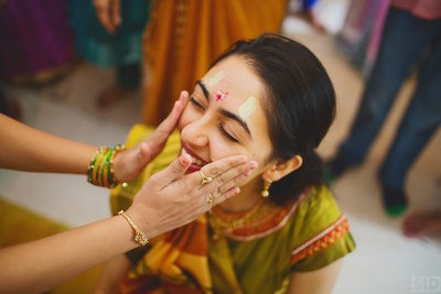 Applying haldi to the bride !