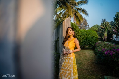 the bride in a yellow lehenga for her haldi