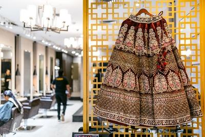 A mesmerizing heavily embroidered burgundy lehenga skirt!