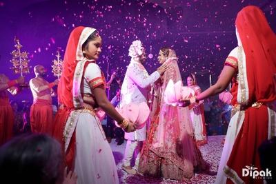 Varmala exchange between the bride and groom before the wedding function