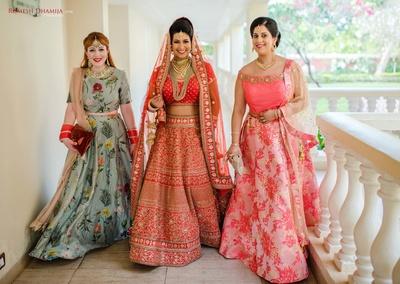 bride entering the wedding ceremony with her bridesmaids