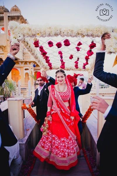 Kriti wearing blood red gotta patti work lehenga for her wedding day.