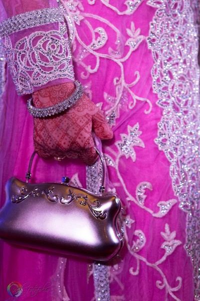 Baby pink dress embellished with floral thread work and stones, styled with silver metal arm candy