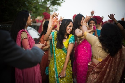 Wedding guests dressed in traditional Indian sarees