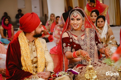 Candid capture between bride and groom during the wedding ceremony